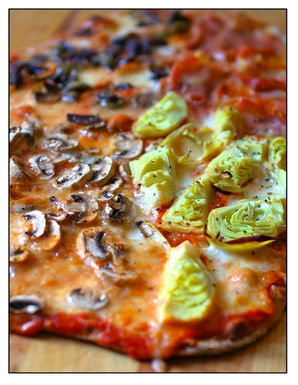 Pizza Quattro Stagioni ~A four section pizza that is traditionally made with artichokes, mozzarella, tomato sauce, ham and olives, but you can play around with it and make it with any combination you like.