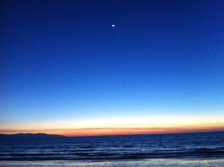 Puerto Vallarta sunset with the moon in the sky