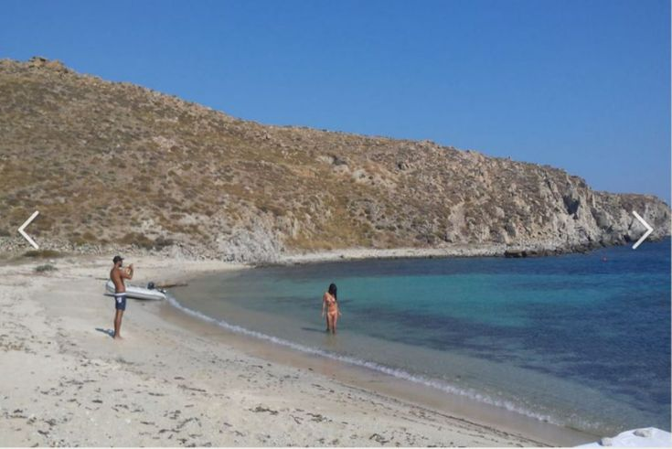 Swimming in the deserted beaches of Rhenia Island. Where is Rhenia Island in Greece - Double Click on the photo for more information. #Mykonos www.guidora.com/blog