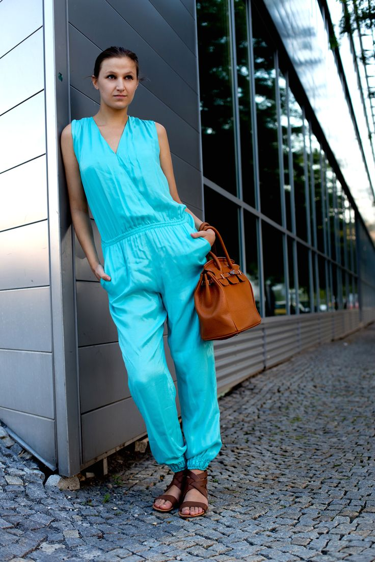 Summer flashback. Fashion street style. Blue jumpsuit.