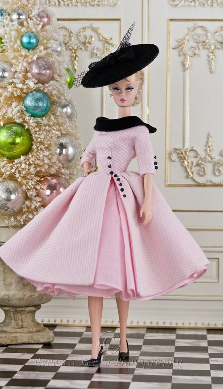 A fabulous pink and black dress coat hybrid for Silkstone Barbie... with a matching black flat rim hat...