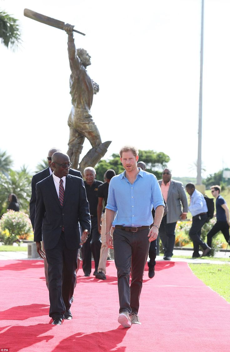 Prince Harry takes a tour of the stadium, taking time to meet cricket legends Sir Viv Rich...
