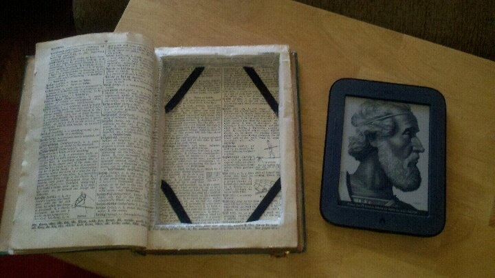 """I paid $2 for the old dictionary at a """"junk"""" store.  Glued the edges, and put in elastic straps in, then cut out the inside with a razor.  This took about 2 hours of my time.  Leave a few pages up front untouched.  Now I have a one of a kind nook protector and only paid $2 and two hours worth of """"time.""""  :): Front Untouch, Hour Worth, Ephemera Remix, Kindness Nooks, Nooks Protector, Cut Outs, Elastic Straps"""