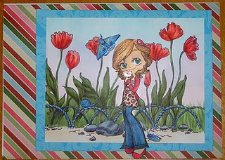 This is a card without a sentiment on the front.  Background is from Make It Crafty and female is Some Odd Girl.  All is colored with Copic markers and blinged out with Spica glitter pens.