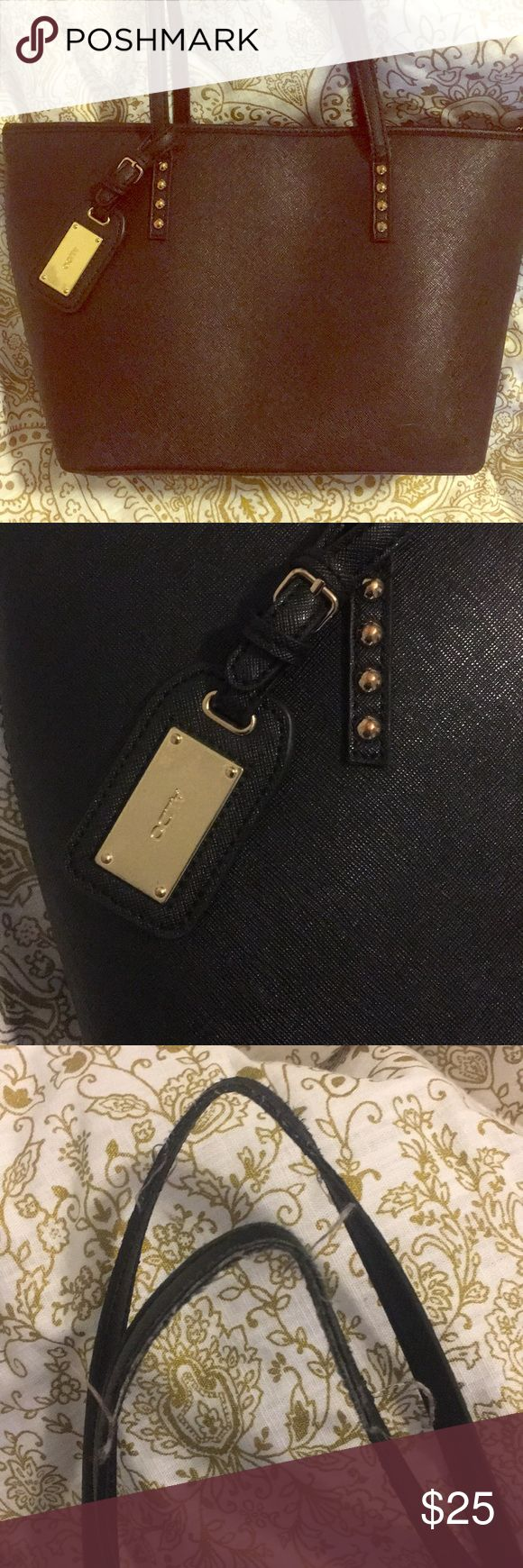 Black aldo tote purse Black faux saffiano leather tote purse from Aldo. Gently used for only a couple weeks.. the tote bag style just isn't for me. I am moving so make me an offer! Everything in my closet must go! Aldo Bags Totes