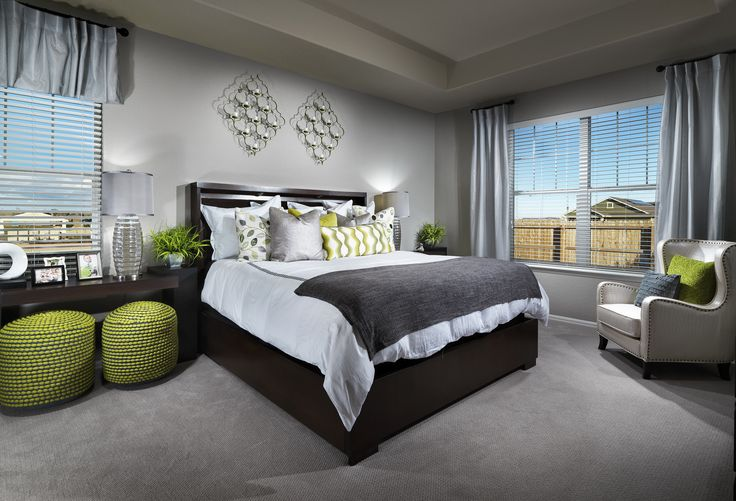 Do you LIKE the pops of green in this master suite?!