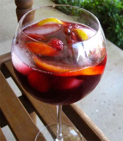 Best Sangria Recipe!    1 bottle of red wine  • ½ cup peach schnapps  • ½ cup pomegranate juice  • ½ cup fresh lemon juice (use fresh lemons!)  • 2 peaches, sliced  • 1 orange, sliced  • 2 lemons, sliced  • ½ pint of raspberries   • 24 ounces of raspberry flavored soda water (or plain club soda)    I will have to update if it's actually THE best ;)