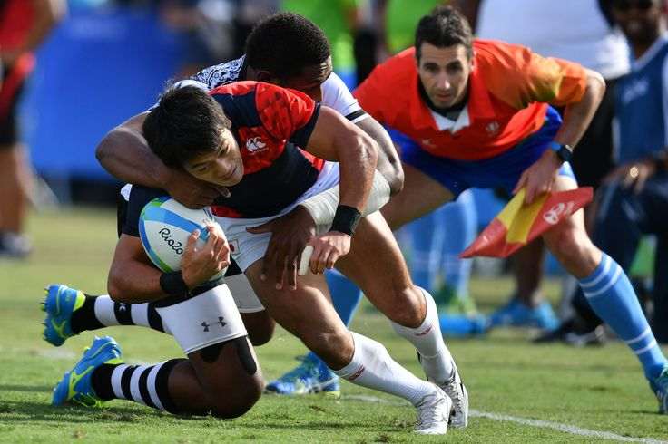 Japan's Shohei Toyoshima is tackled in the mens rugby sevens semi-final match between Fiji and Japan during the Rio 2016 Olympic Games at Deodoro Stadium in Rio de Janeiro on August 11, 2016. / AFP / Pascal GUYOT
