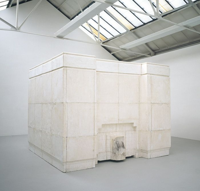 Rachel Whiteread, ghost, 1990. (negative cast of an entire room interior from a Victorian house, complete with the pattern of marks left by the door to the room. It's not about the solidification of space, but  rather its absence).