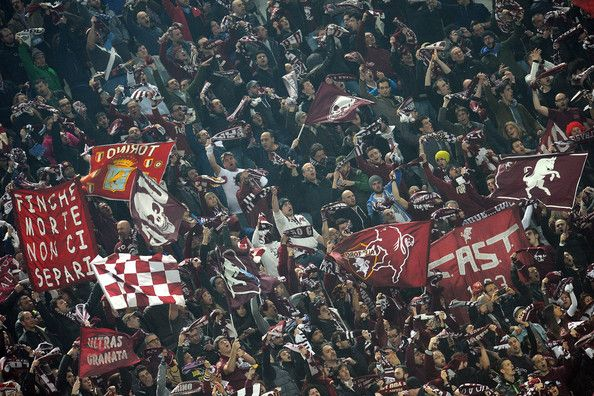 Fans of Torino FC show their support during the Serie A match between Juventus and Torino FC at Juventus Arena on February 23, 2014 in Turin...