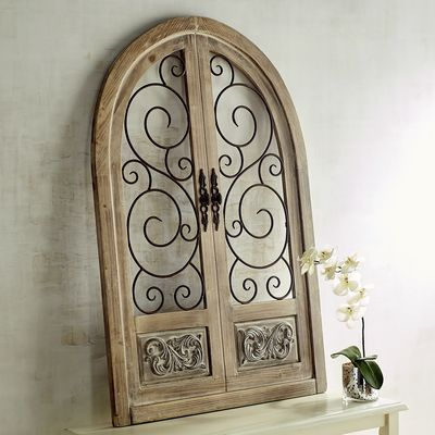 With a generous height of over 3 feet, our arched wall decor will be a gorgeous piece to build a look around. Is it a secret doorway or a window to a fantastical view? Either way, with its lightly distressed fir frame and wrought iron swirls, you're certain to be inspired to new decorating heights.