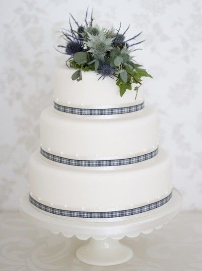The Liggy's Cake Company - special handmade cakes Simply Stylish Range: Scottish Thistle Three sponge tiers covered with ivory fondant and finished with a traditional Scottish spray of foliage, bands of tartan ribbon over ivory satin. Cake serves 100 guests