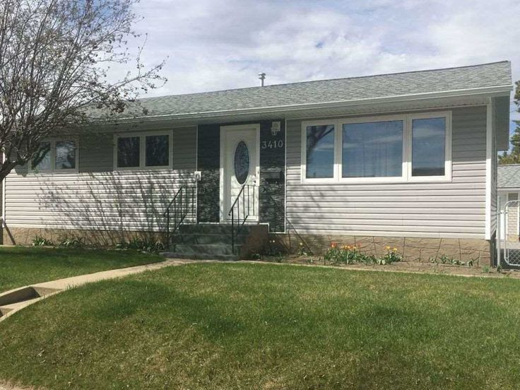 Extensively renovated bungalow in a quiet neighborhood of large lots and mature trees.  Both the...