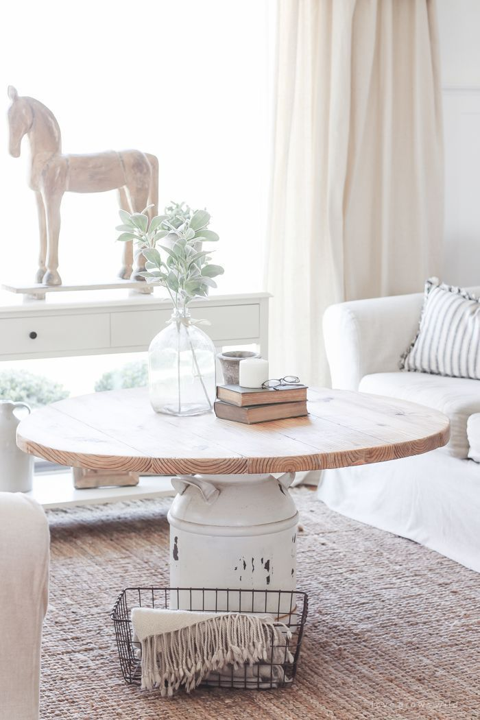 How to turn an old milk can into a gorgeous coffee table! See how this blogger created a unique piece of furniture on a budget!