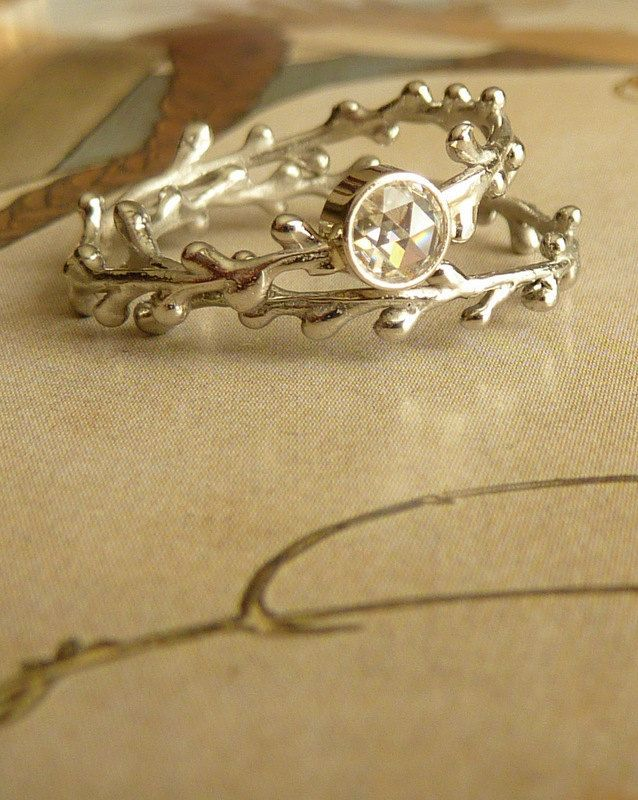 gorgeous alternative engagement ring and band.  Love how unusual rings are coming more into fashion than just giant diamonds.  Rose Cut Moissanite Wreath Ring. $445.00, via Etsy.