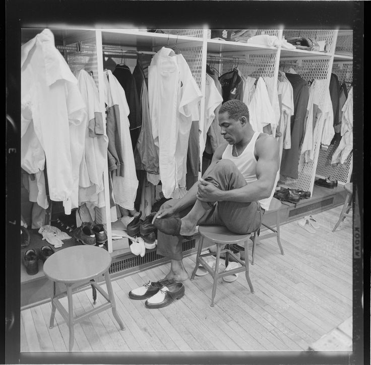 Untitled Cardinal Baseball Player Minnie Minoso In Locker Room Changing Shoes