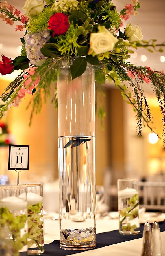 25 best ideas about fish wedding centerpieces on for Fish wedding centerpieces