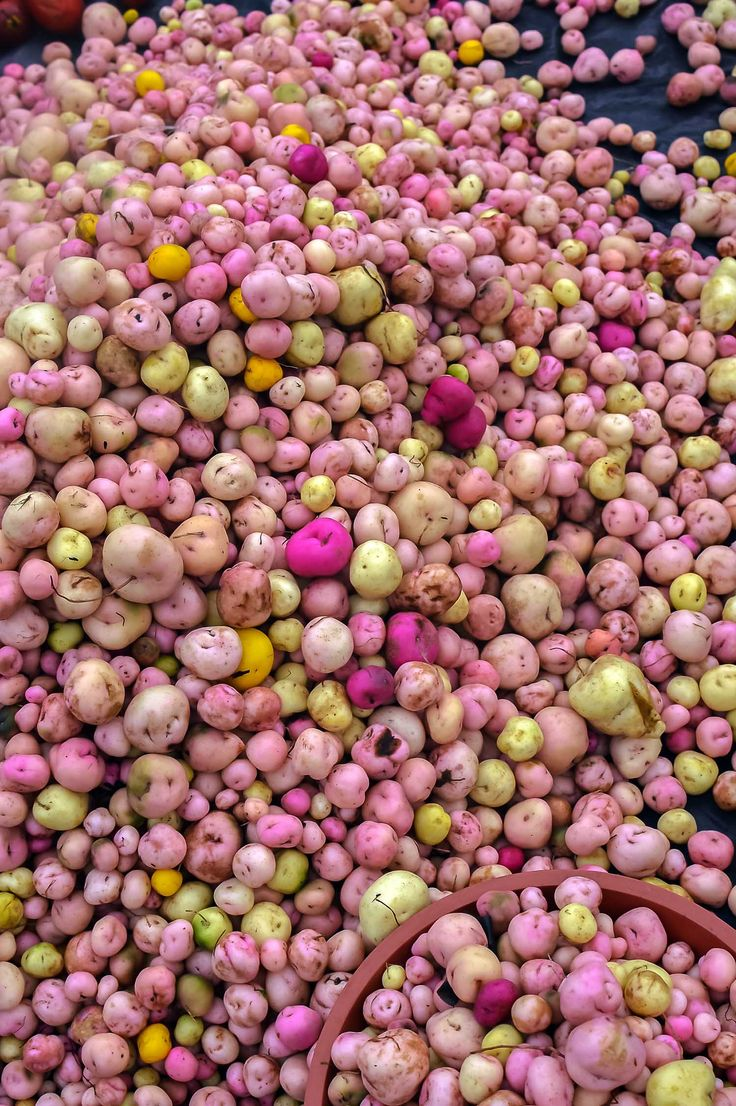 Stunning mellocos pink potatoes at Otavalo Market, Ecuador, Yes, they are the real colours! | heneedsfood.com