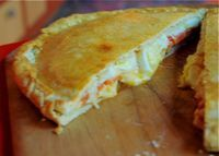 Torta de fiambre is a savory pie, filled with ham, cheese and eggs.