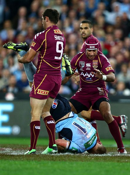 Luke Lewis of the Blues is up-ended in a tackle during game one of the ARL State of Origin series between the New South Wales Blues and the Queensland Maroons at ANZ Stadium on June 5, 2013 in Sydney, Australia.