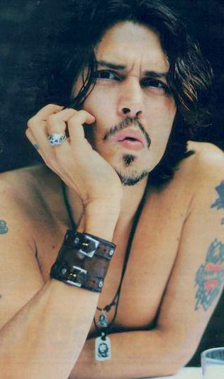Johnny Depp with sexy moustache.