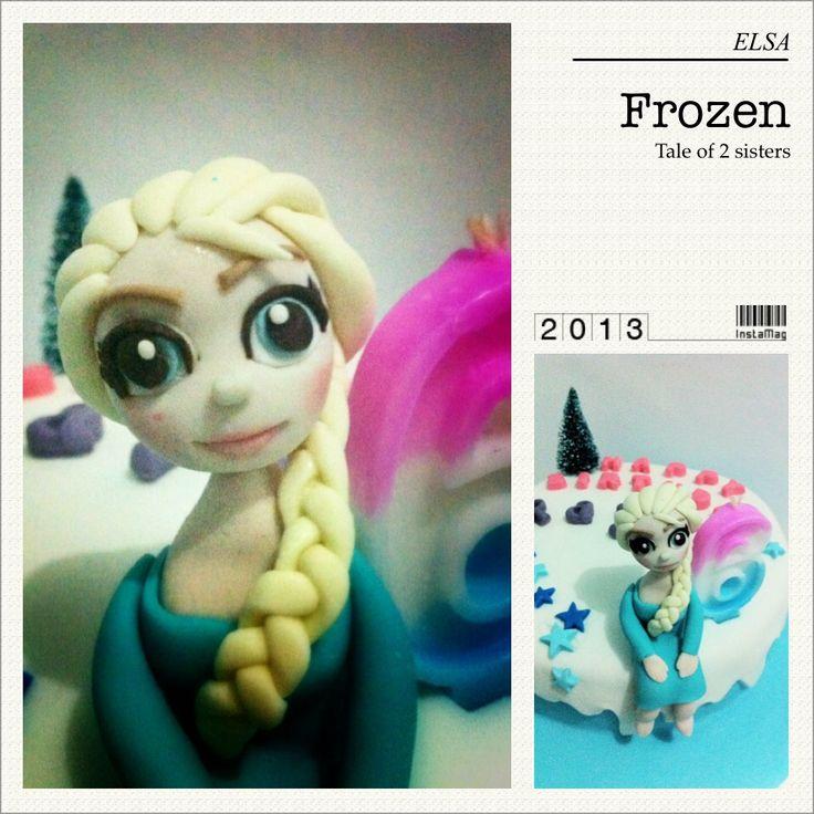 Frozen cake with Elsa figurine