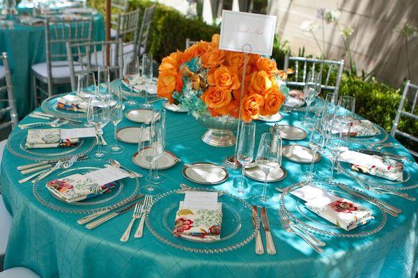 bright table decor - blue and orange wedding table decoration