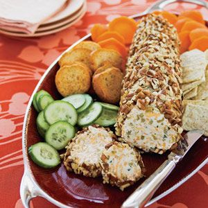 Include make-ahead appetizers such as these cheddar cheese logs in your party menu. Green chiles and cayenne pepper give a Tex-Mex style to the spread.