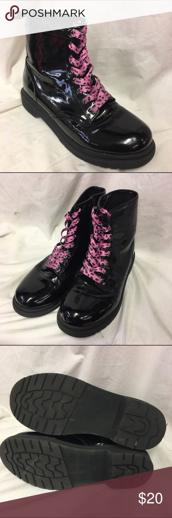Cherokee Girls 5 Black Lace Up Boots Doc Look Cherokee Girls 5 Black Lace Up Boots Doc Look Alikes 5  Very good used condition.  Pink leopardy print laces.  Black patent finish.  Thick soles.  Heavy to ship.  Look like Doc Martens.  #docs #looklikedocs #pink #laceup #punkrock #boots #black #blackboots #punk Cherokee Shoes Boots