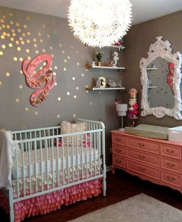 I like the wall decals with the letter, and the light fixture, ruffles, and character giving mirror and dresser. It is like mixing shabby chic with glittery refinement. I like it a lot, but would probably have a few different color choices. More bright!