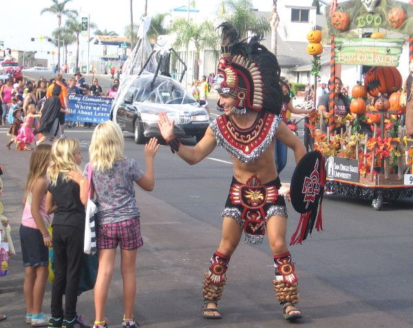 san diego state university | The San Diego State University mascot Aztec Warrior gives a high five!