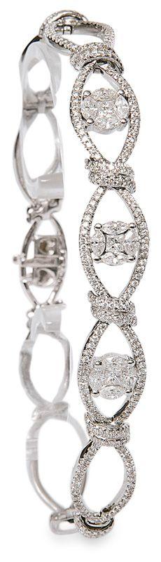 A diamond bracelet  18 ct. white gold. The bracelet with 200 round cut diam., 12 navette diam. and 3 princess diam. in total c. 2,10 ct.