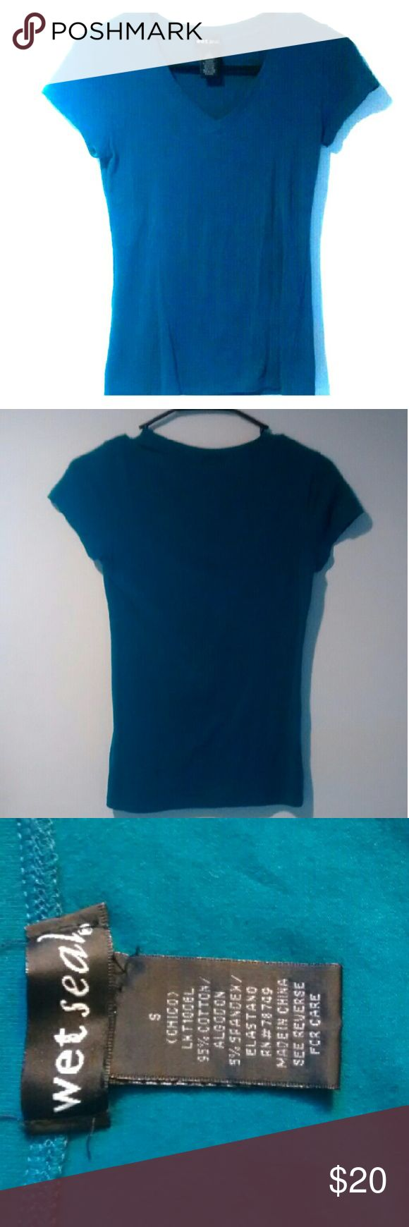 Wet Seal Blue Tight Shirt Only worn once. It's a dark turquoise color and there are no stains or tears. It's in very very good shape, almost like new. Wet Seal Tops Tees - Short Sleeve