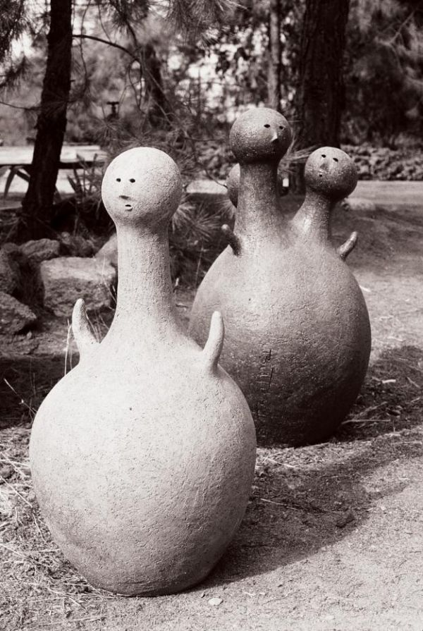 """Whimsical ceramic figures by Stan Bitters—two of his """"People Pots."""""""