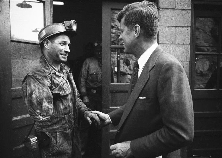 Considered a battleground state in the 1960 primary election, John F. Kennedy meets with coal miners in West Virginia. Kennedy would best Hubert Humphrey in the election and win 60.8% of the primary vote.