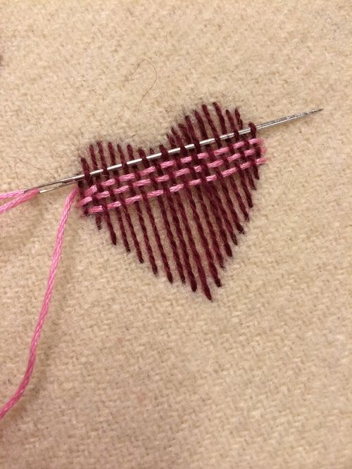 "Surface darning - nice illstration. I might switch to a blunt tapestry needle for the back-and-forth weaving, after laying down the weft with a pointed needle. ""Wear Your Heart on Your Sleeve"" (2014)"