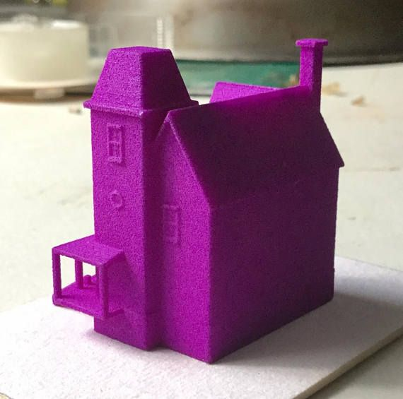 'It's showtime!'  Listing is for a Beetlejuice house model. This tiny house is only available here and is 3D printed in a dark purple plastic. No parts are removable and the interior is hollow. The item can be painted or left in its beautiful purple glory. The house measures approximately