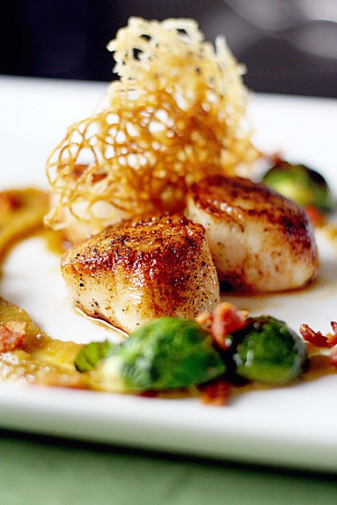 Seared Sea Scallops with Golden Raisin Puree and Bacon Braised Brussels