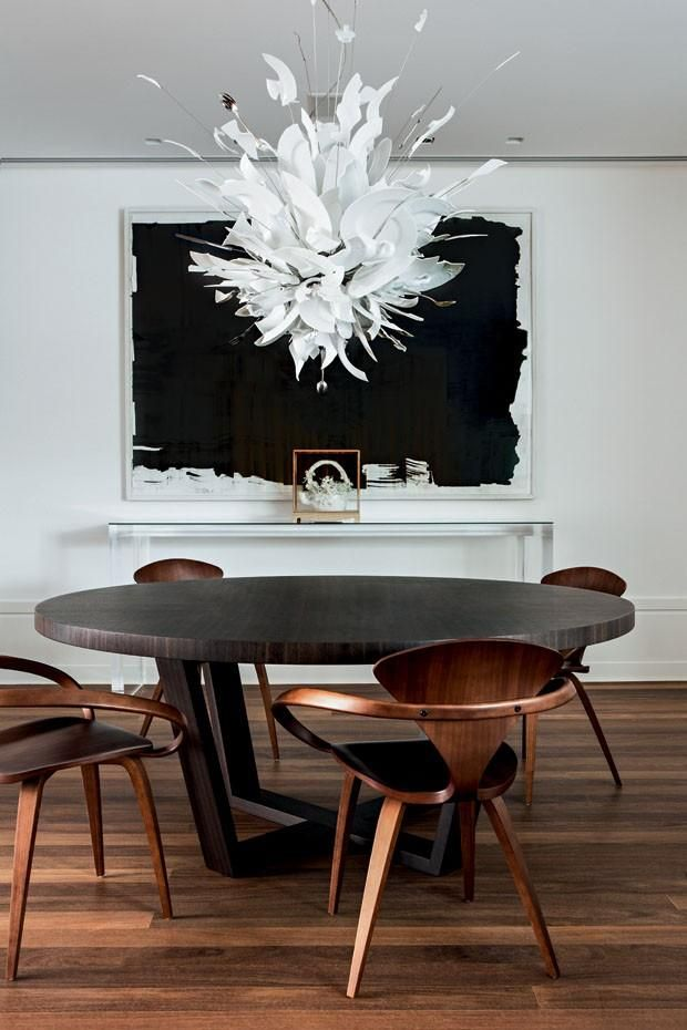 dramatic chandelier and mid-century chairs