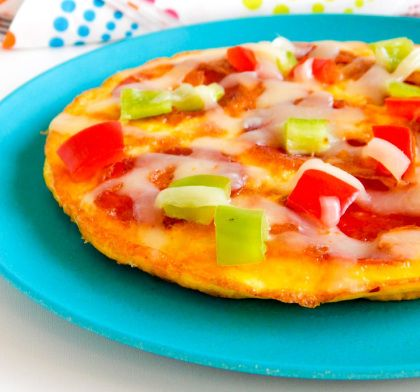 Mini Breakfast Pizza | Courtesy of Lushious Eats | #Eggs #GetCracking For the little ones who'd like to have pizza for every meal, this nutrient-packed recipe is sure to be a winner. With a fried egg as the base, this breakfast pizza includes pepperoni, mozzarella cheese, and red bell pepper.
