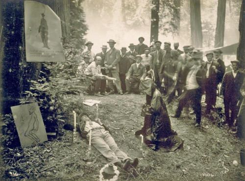 An old photo from Bohemian Grove on the National Geographic website appeared with the following caption:  Power Party  Photograph by Gabriel Moulin, 1915 To purge himself of worldly concerns, a member of the elite Bohemian Club participated in a 1915 Cremation of Care ceremony—complete with candles and a robed and hooded comrade to guide him. This private club of influential men still meets annually north of San Francisco and uses this symbolic ritual to kick off its summer retreat. But…