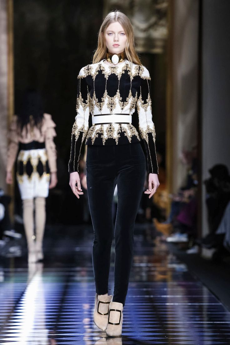 Olivier Rousteing shows his fall collection. Balmain, so well styled-- the choice of color and material for the shoe is perfection..