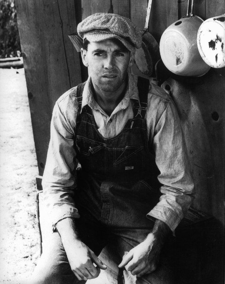 "The Common Man: Henry Fonda wears overalls as the impoverished Tom Joad in The Grapes of Wrath.  ""A poor Midwest family is forced off of their land. They travel to California, suffering the misfortunes of the homeless in the Great Depression."""