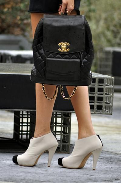 Chanel black leather backpack w/ classic quilted pattern + gold hardware + logo