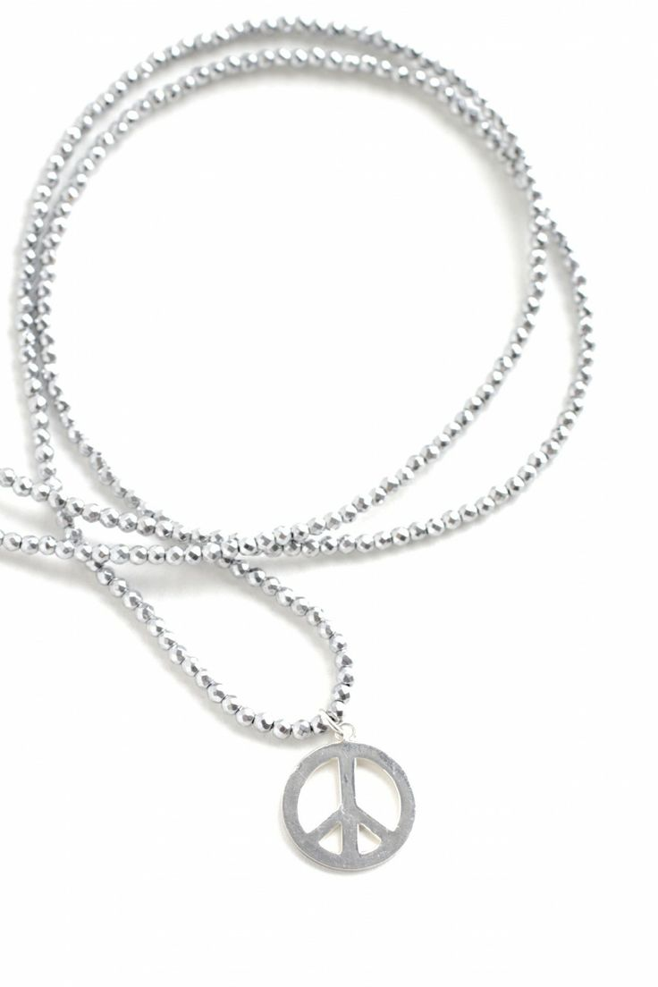 """(http://www.notinthemalls.com/products/""""Silver""""-Hematite-necklace-with-peace-sign.html)"""