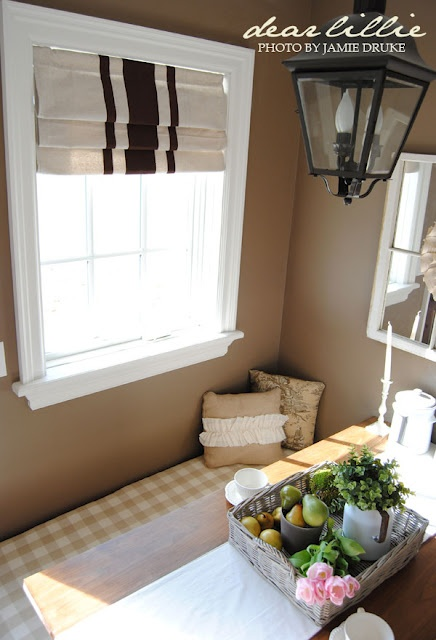 DIY Roman Shades made out of drop cloth + painted stripes