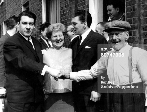 East End London gangsters 1960s, the Kray twins pictured outside their house in Vallance Road. They are L-R: Ronnie, their mother Violet, Reggie and Grandfather Jimmy Lee.