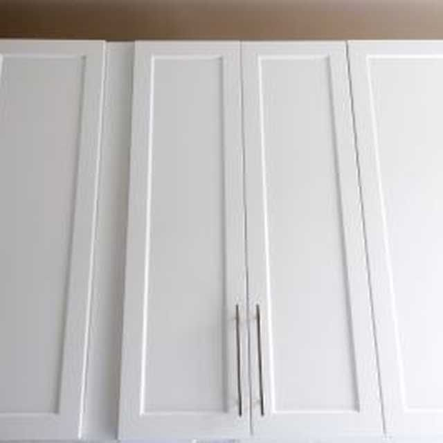 Painting laminate cabinets can make them look new.