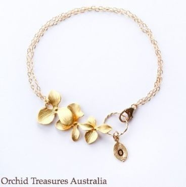 This gorgeous orchid charm bracelet is ideal for any special occasion.    Handmade sterling silver bracelet with white gold plated orchids to offer a stunning and delicate piece to accompany the perfect dress. Attached is a hand-stamped Initial leaf. Please select your letter.  Extra charms can be added such as small real orchids preserved in resin and extra sterling silver engraved orchid leaves. $45