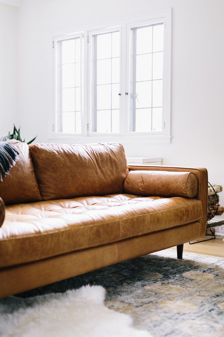 Find this pin and more on objects this brown leather couch